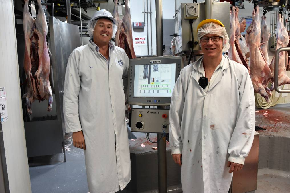 Will Barton, CEO of Gundagai Meat Processors, and lamb floor manager, Jason Crane, with the plant's DEXA unit which measures lean carcase yield.